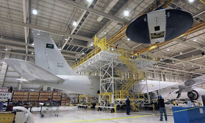 U.S. Air Force personnel work on a Saudi E-3A Sentinel at Tinker Air Force Base.