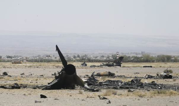 The wreckage of a Yemen air force fighter jet is seen after it was destroyed by Saudi bombing