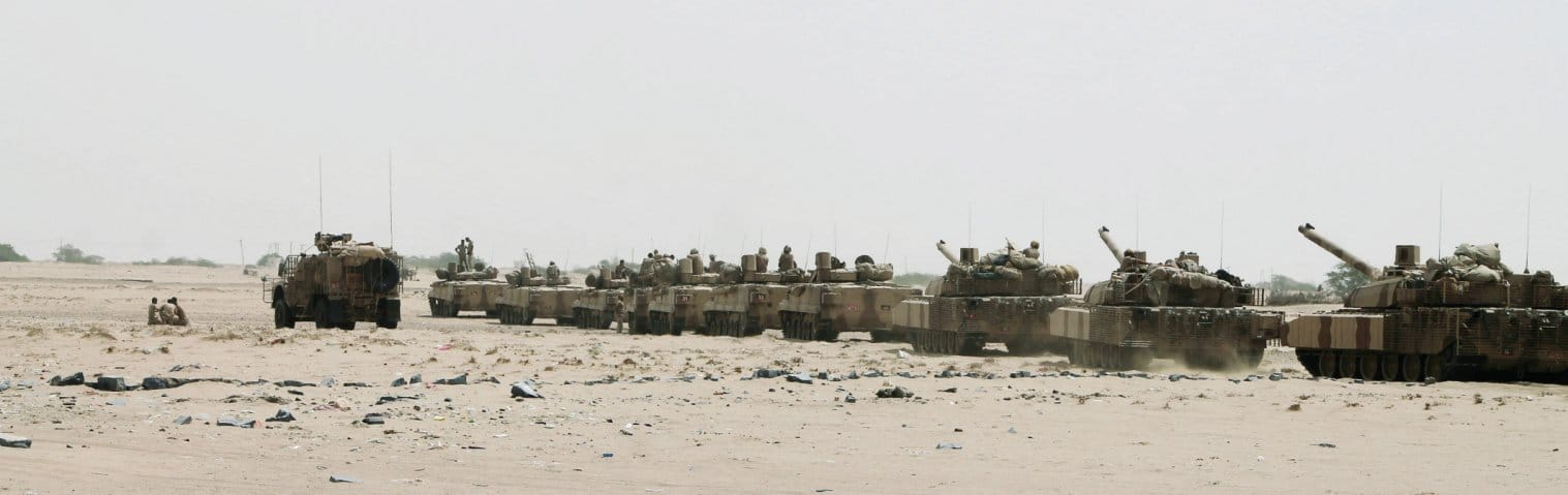 A column of Emirati Leclercs and BMP-3s pauses during the advance from Aden to Al-Anad. (PA Photos)
