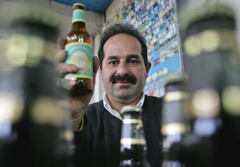 Palestinian beer maker Nadim Khoury holds an empty bottle of non-alcoholic beer in his brewery in the West Bank village of Taiybeh, near Ramallah. Loay Abu Haykel / Reuters