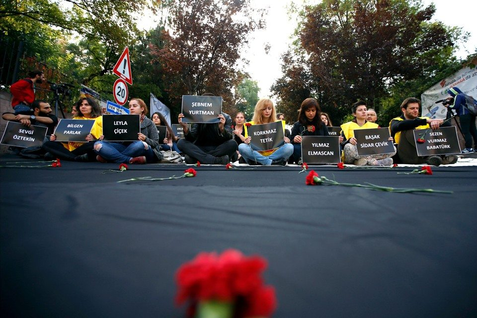 Students of Ankara University hold placards with the names of those killed in Saturday's deadly explosions during a sit-in protest in Ankara, Turkey, Tuesday, Oct. 13, 2015. Authorities in Istanbul banned a protest rally and march by the same trade union and civic society groups who lost friends and colleagues in Turkey's bloodiest terror attack. Dogan news agency video footage on Tuesday showed police pushing back dozens of demonstrators trying to reach the rally to commemorate the 97 victims of the twin suicide bombings. Some demonstrators were detained.(AP Photo/Emrah Gurel)