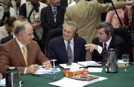 Ahmed_Chalabi_in_discussion_with_Paul_Bremer_and_Donald_Rumsfeld
