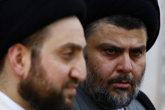 Iraqi Shi'ite cleric Moqtada al-Sadr and Ammar al-Hakim, leader of the Islamic Supreme Council of Iraq (ISCI), hold a news conference in Najaf