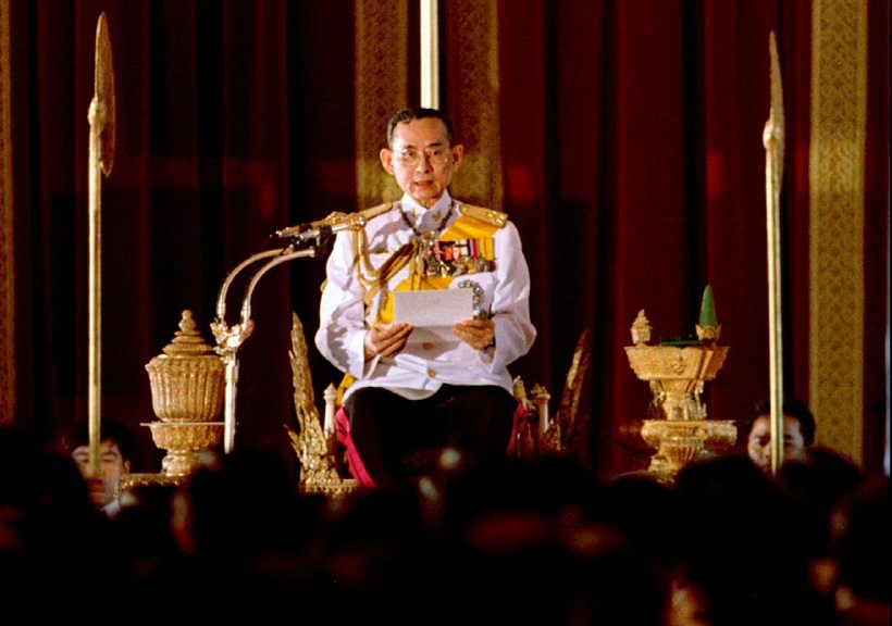 File photo of Thai King Bhumibol Adulyadej reading a statement convening Parliament in Bangkok