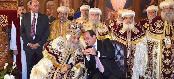 """Egyptian Coptic Pope Tawadros II (L), Pope of the Coptic Orthodox Church of Alexandria and Patriarch of Saint Marc Episcopate receives Egyptian President Abdel Fattah al-Sisi (R), at the new Coptic Cathedral at the new Coptic Cathedral """"The Nativity of Christ"""" in the new administrative capital, 45 km east of Cairo, Egypt January 6, 2018"""